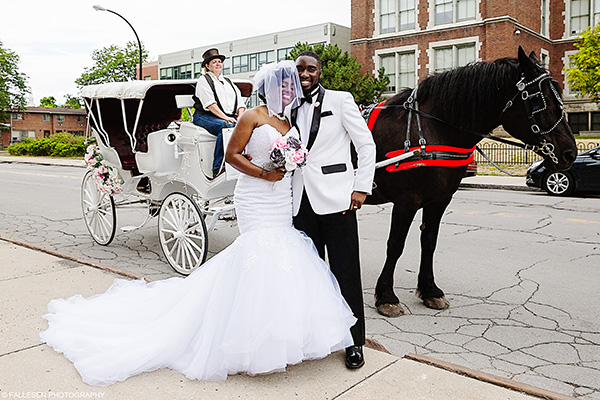 Bride and Groom in front of Horse drawn carriage at the Kirkwood Wedding in Buffalo, NY