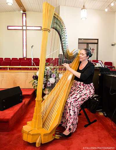 Photograph of a harpist playing at the Kirkwood Wedding in Buffalo,NY