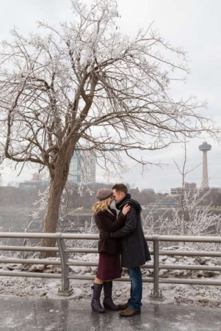 Engaged couple at Niagara Falls, NY during the winter