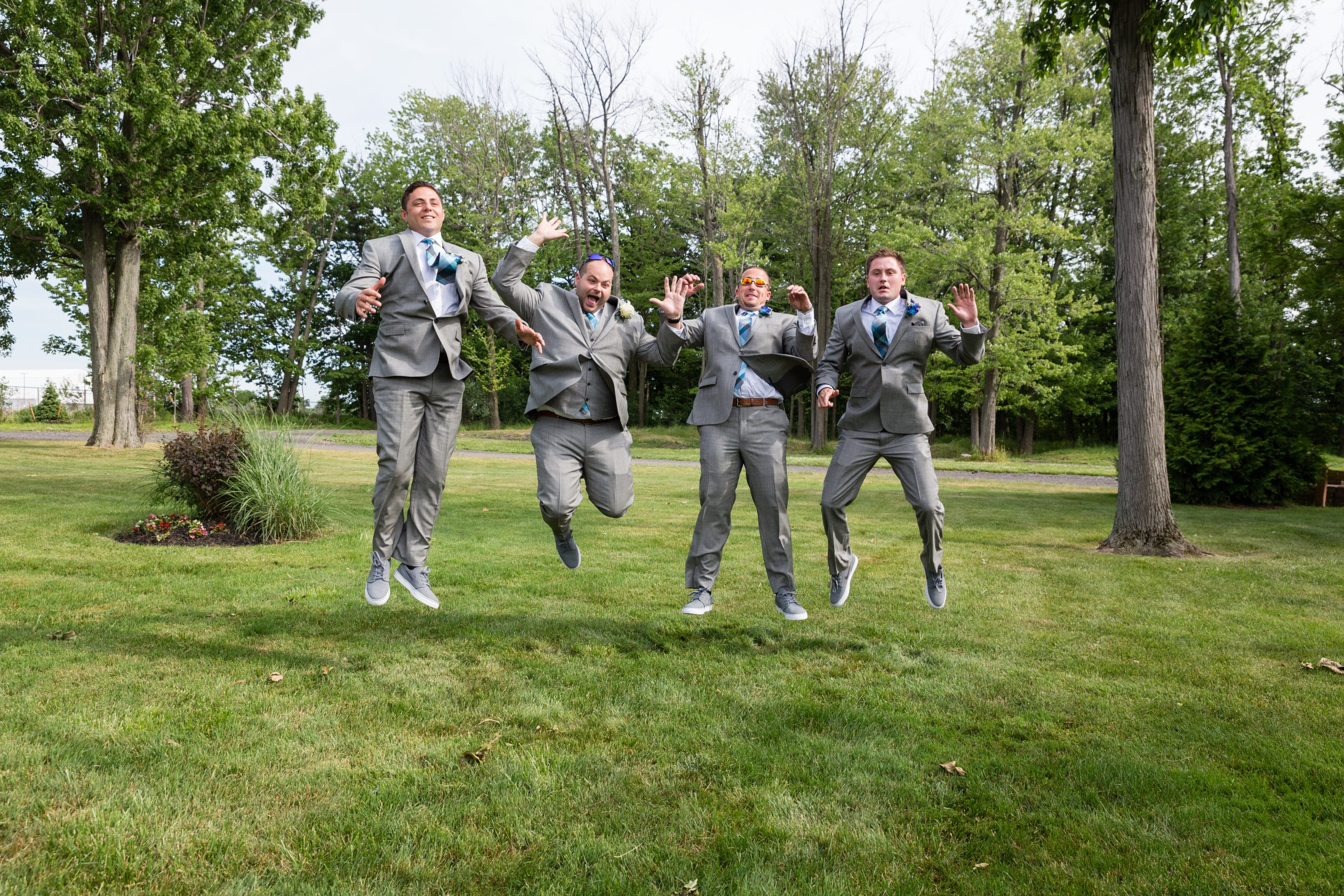 Funny wedding pose ideas with Groomsmen jumping Le Galleria Orchard Park NY by Fallesen Photography LLC
