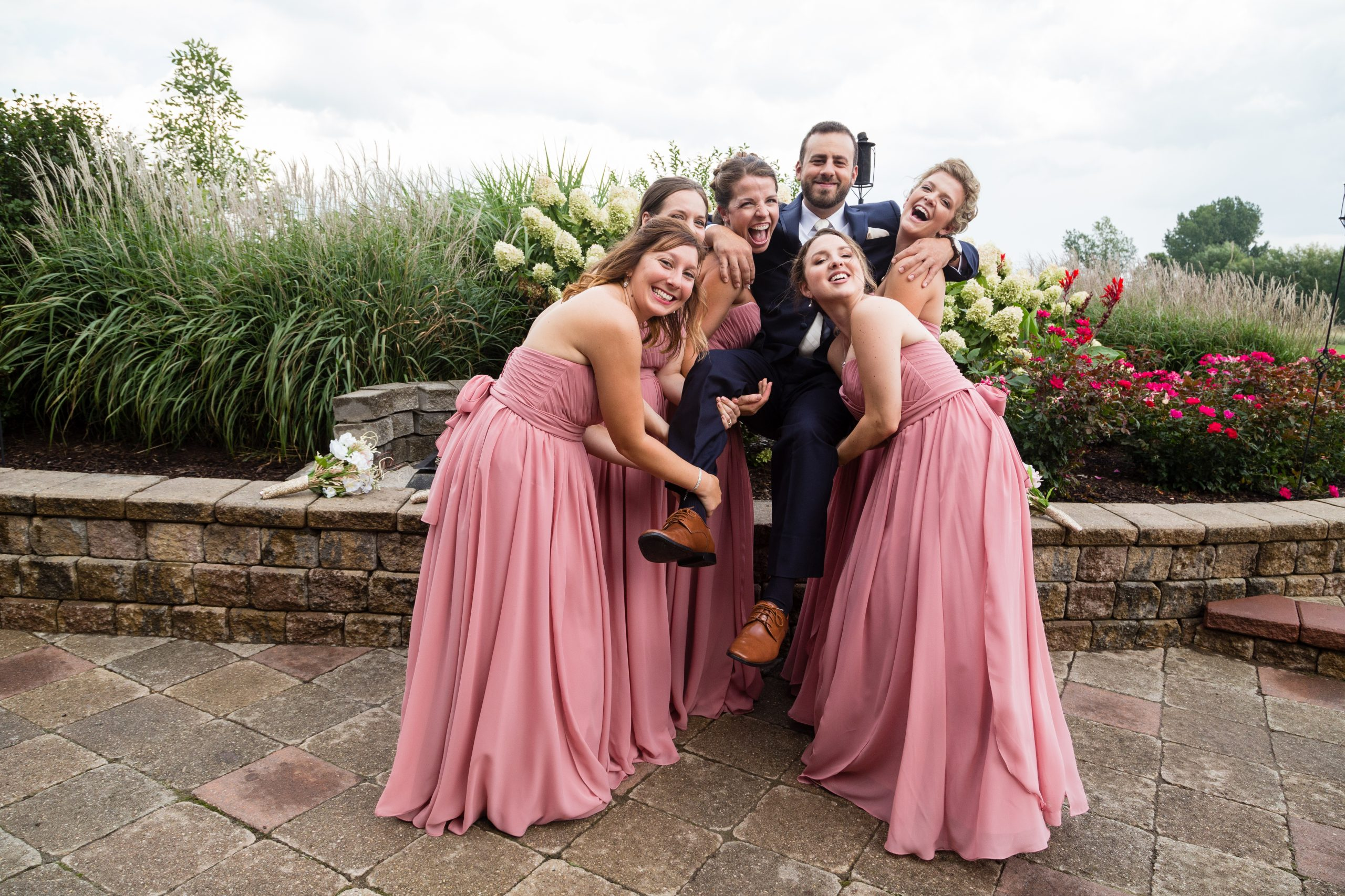 Funny wedding pose ideas with Bridal Party drinking at Timberlodge in Akron NY by Fallesen Photograph LLCy